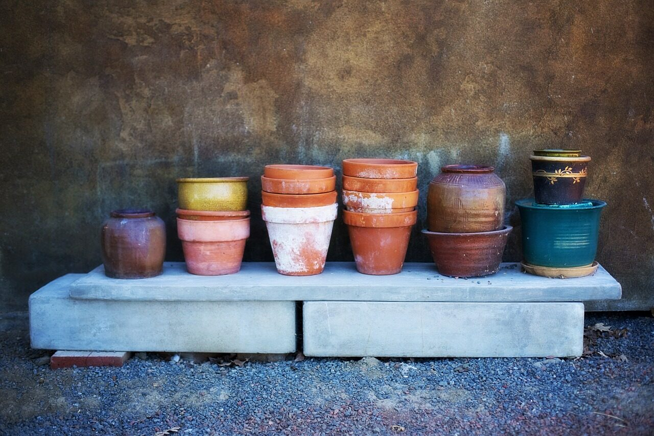 Potting table with miscelanous terracotta pots