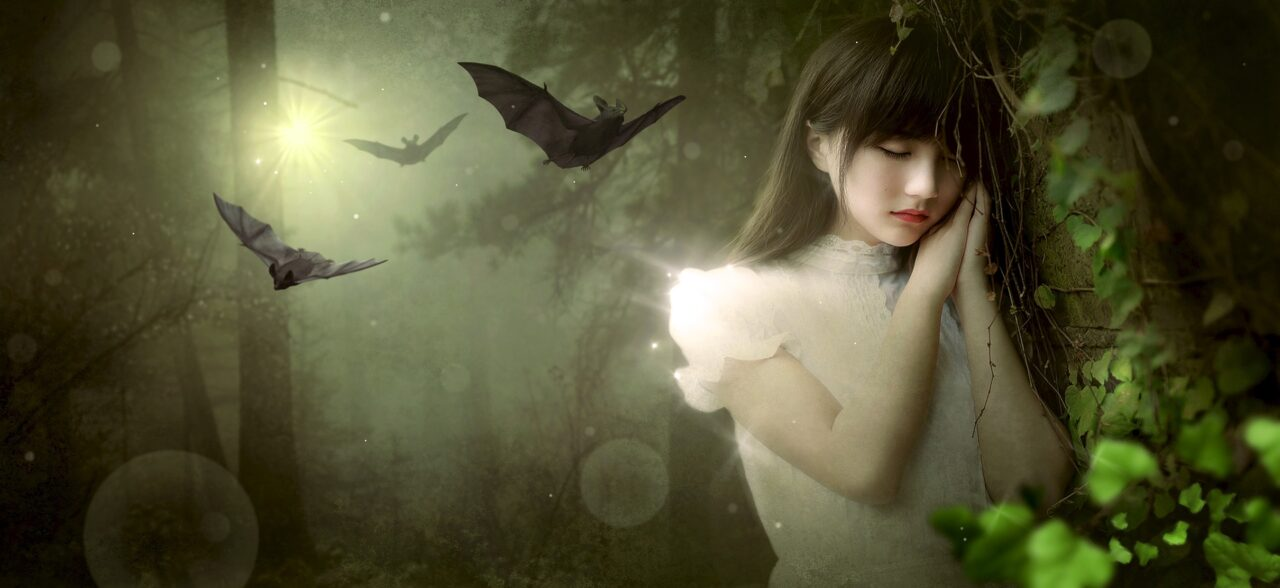 Young woman in dreess in a dark forest on a moonlit night as bats fly in background
